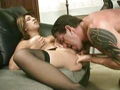 Tattooed hunk bangs with busty brunette babe on the sofa